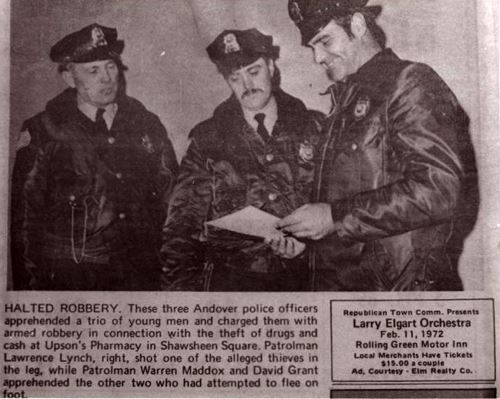 A newspaper clipping with a picture of three police officers.
